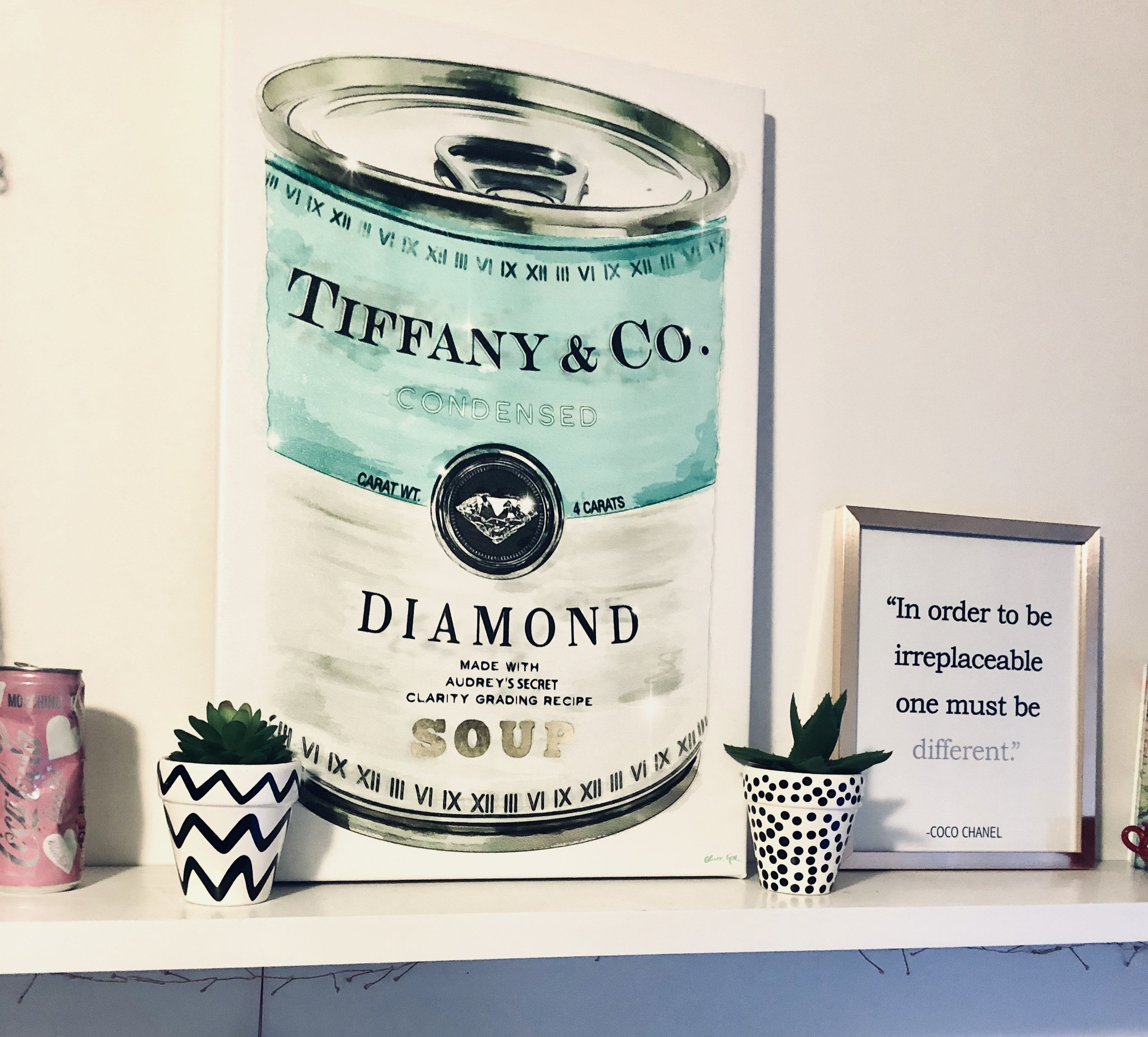 the canvas art of a tiffany and co. soup can in a buzzfeed editor's room