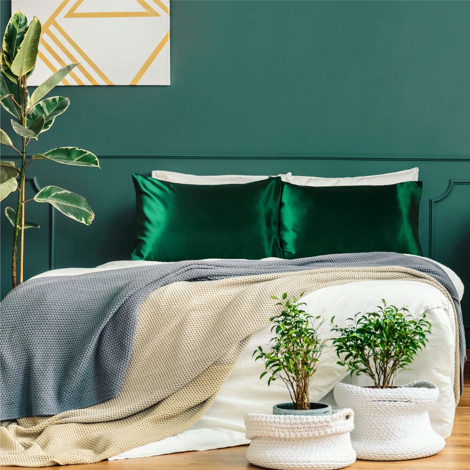 green satin pillowcases on a bed