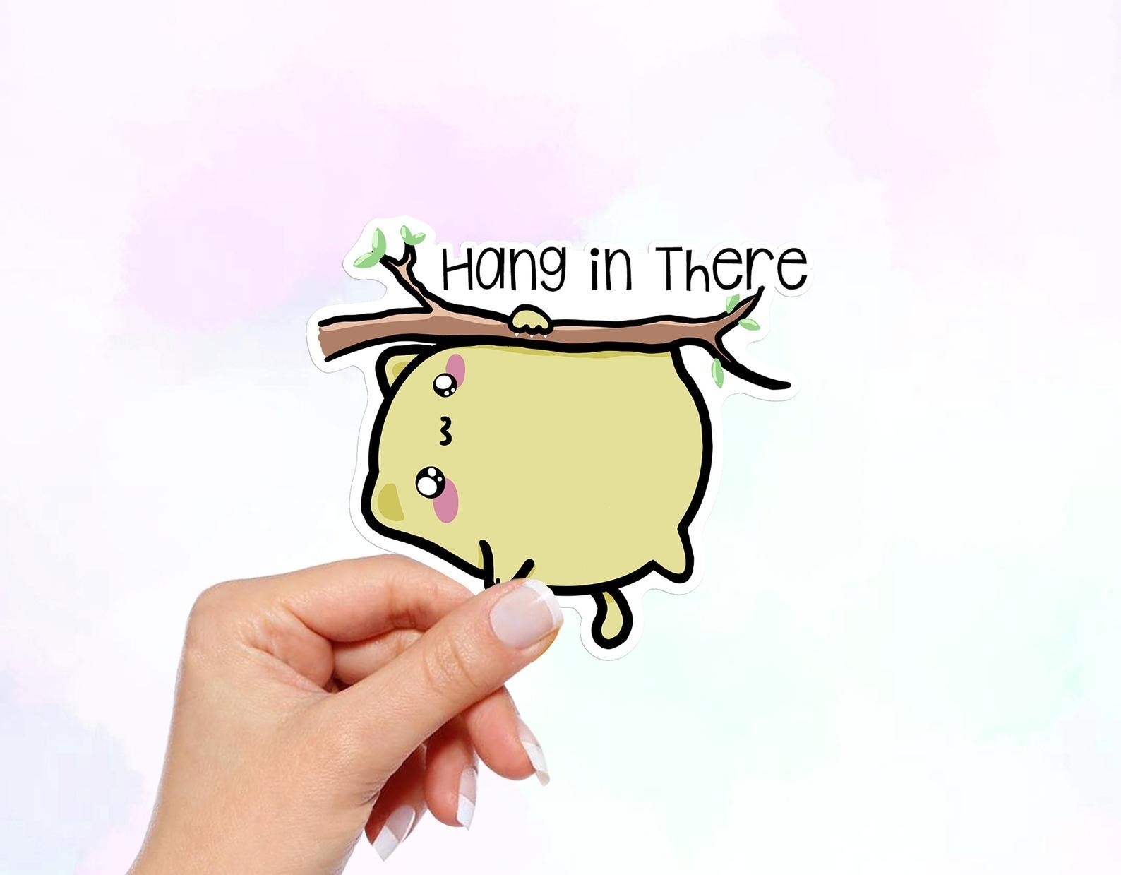 "a cute anime-like cat hanging on a branch with the words ""hang in there"""