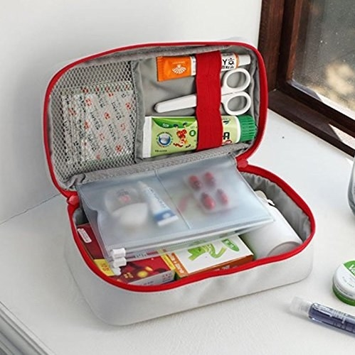 First aid kit with tablets and medicines in it.