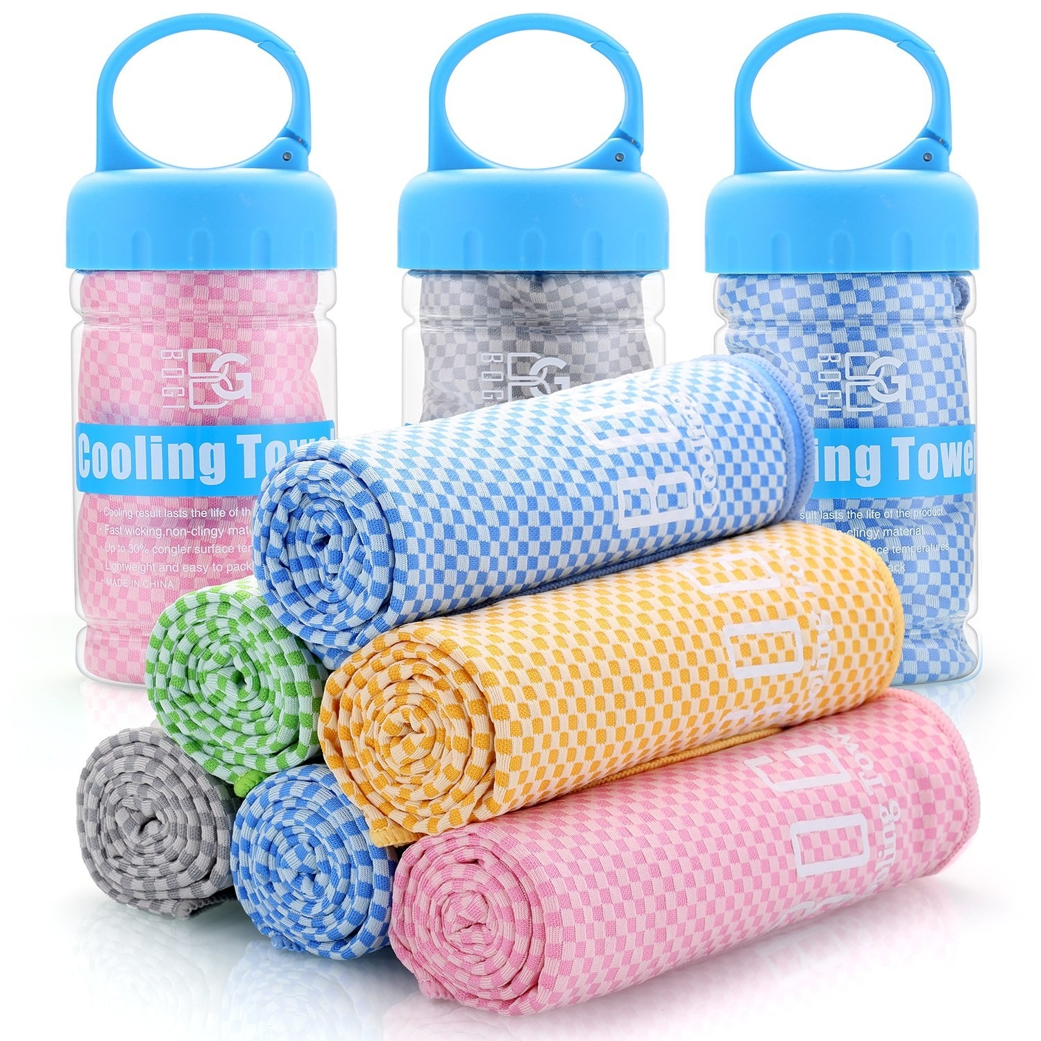 Rolled towels are stacked in a pyramid form with three containers that have towels in them in the background