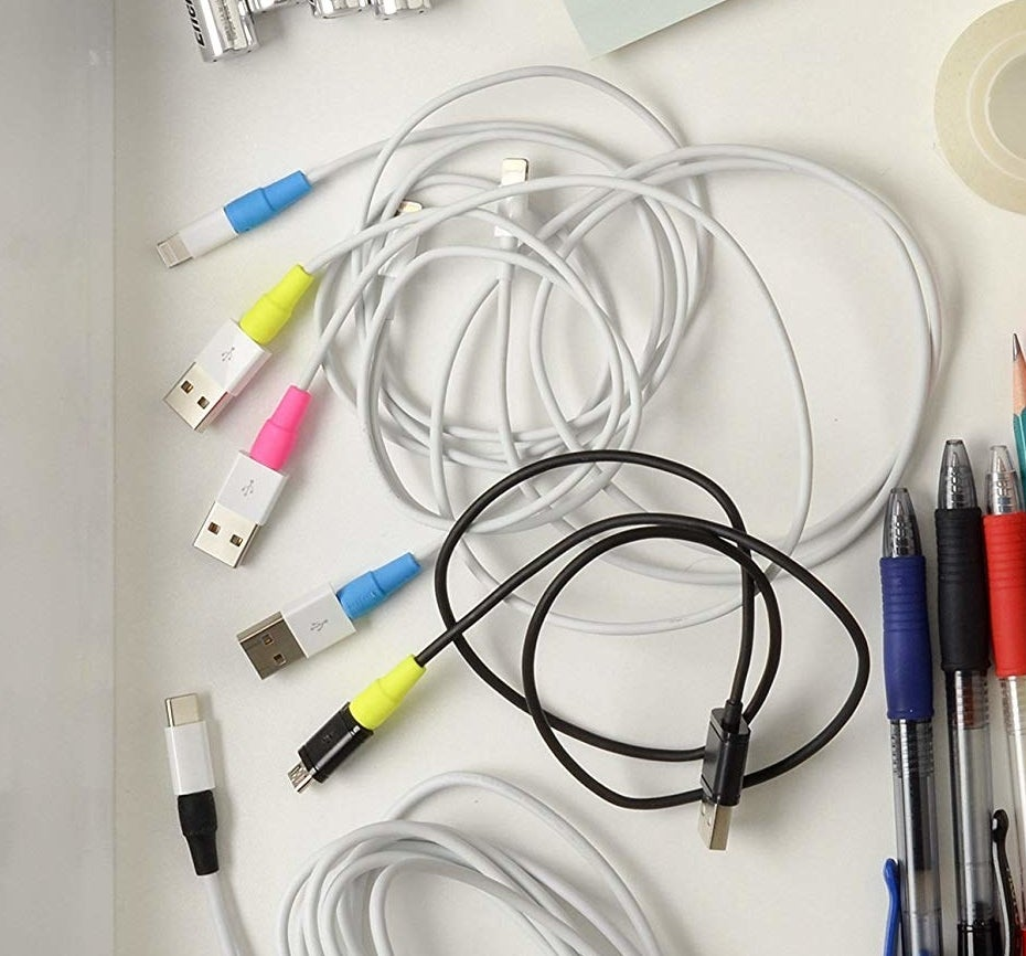 Wires in a desk drawer with cord protectors on them