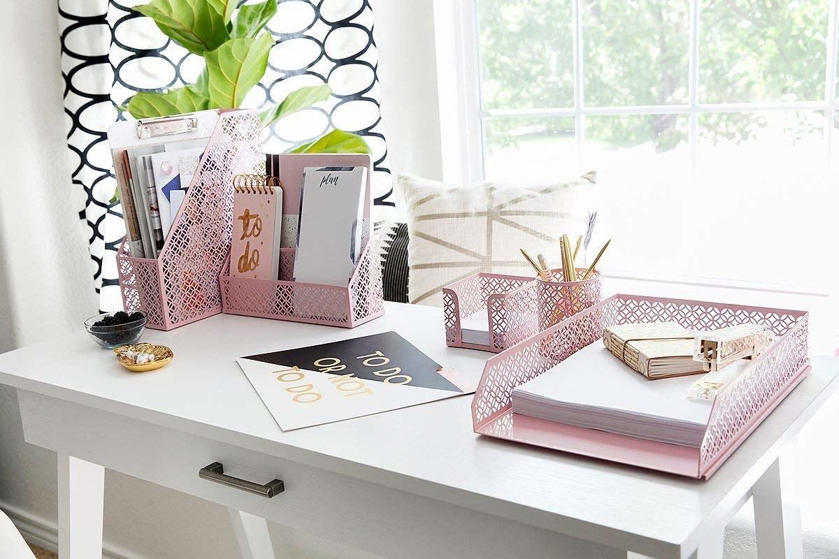 The pink accessories on a desk