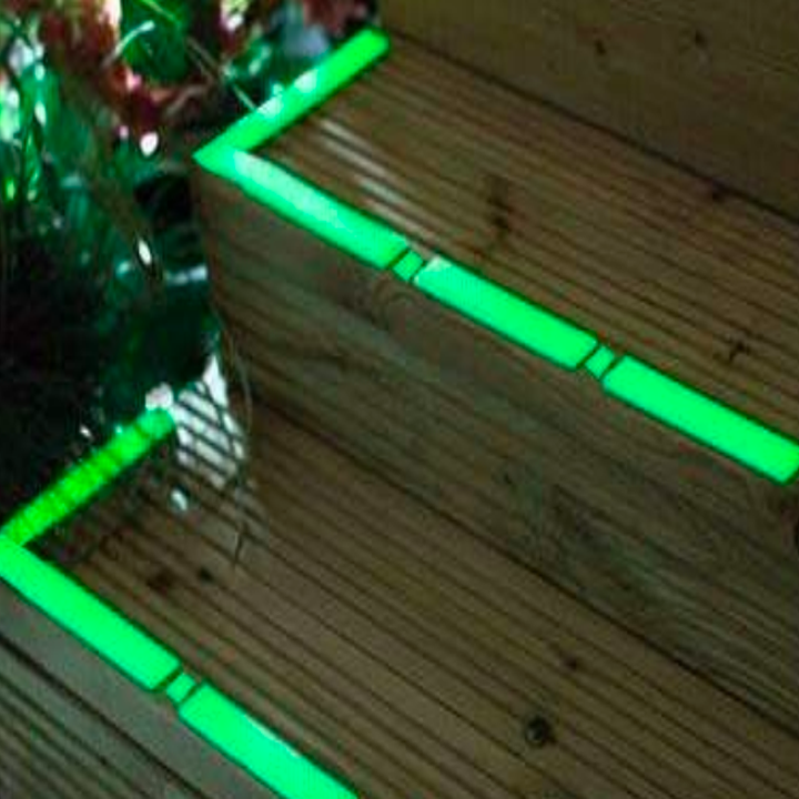 Porch steps covered in bright glowing green tape