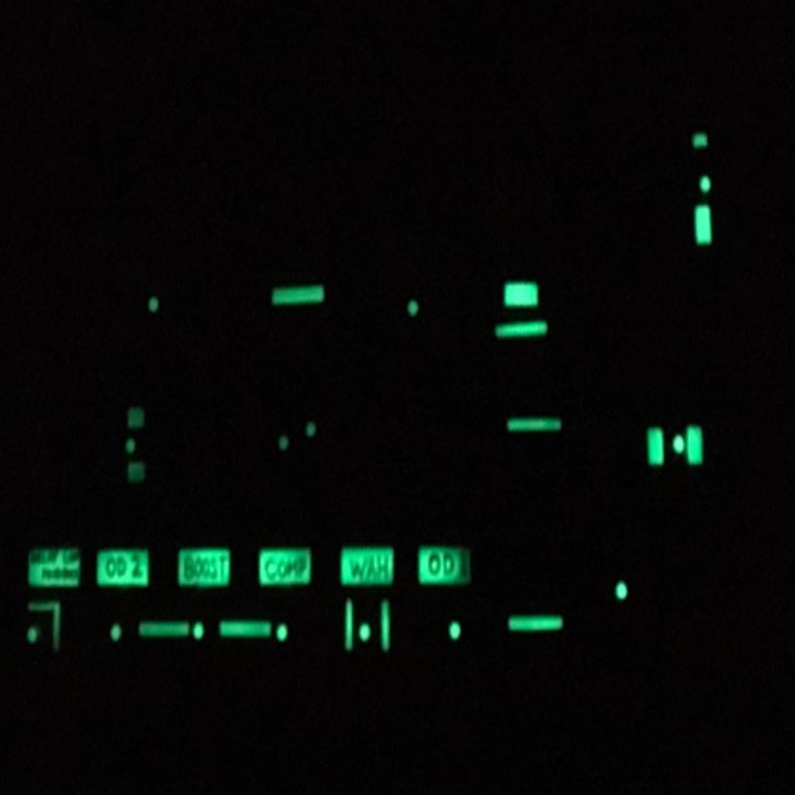 Buttons for radio covered in glowing tape