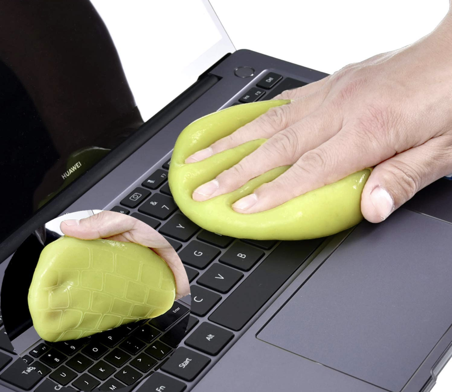 A model using a yellow squishy gel to press on a keyboard and pull up crumbs