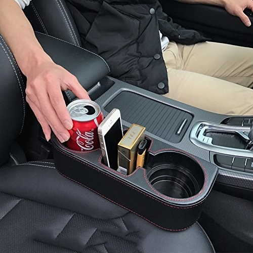 Middle console car organizer with two cup holders and a middle compartment for phones and other things