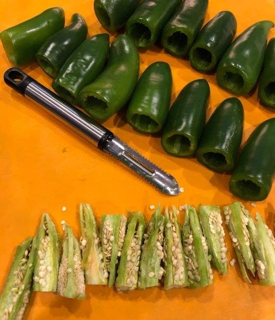 Reviewer image of the jalapeño corer with a number of clean cored jalapeño in the top of the images all of the cores in the bottom of the image