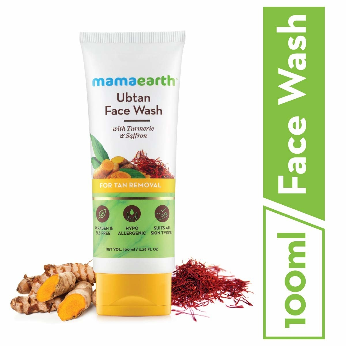 Tube of the face wash next to turmeric and saffron.