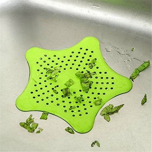 Green star shaped sin catcher with food bits on it.