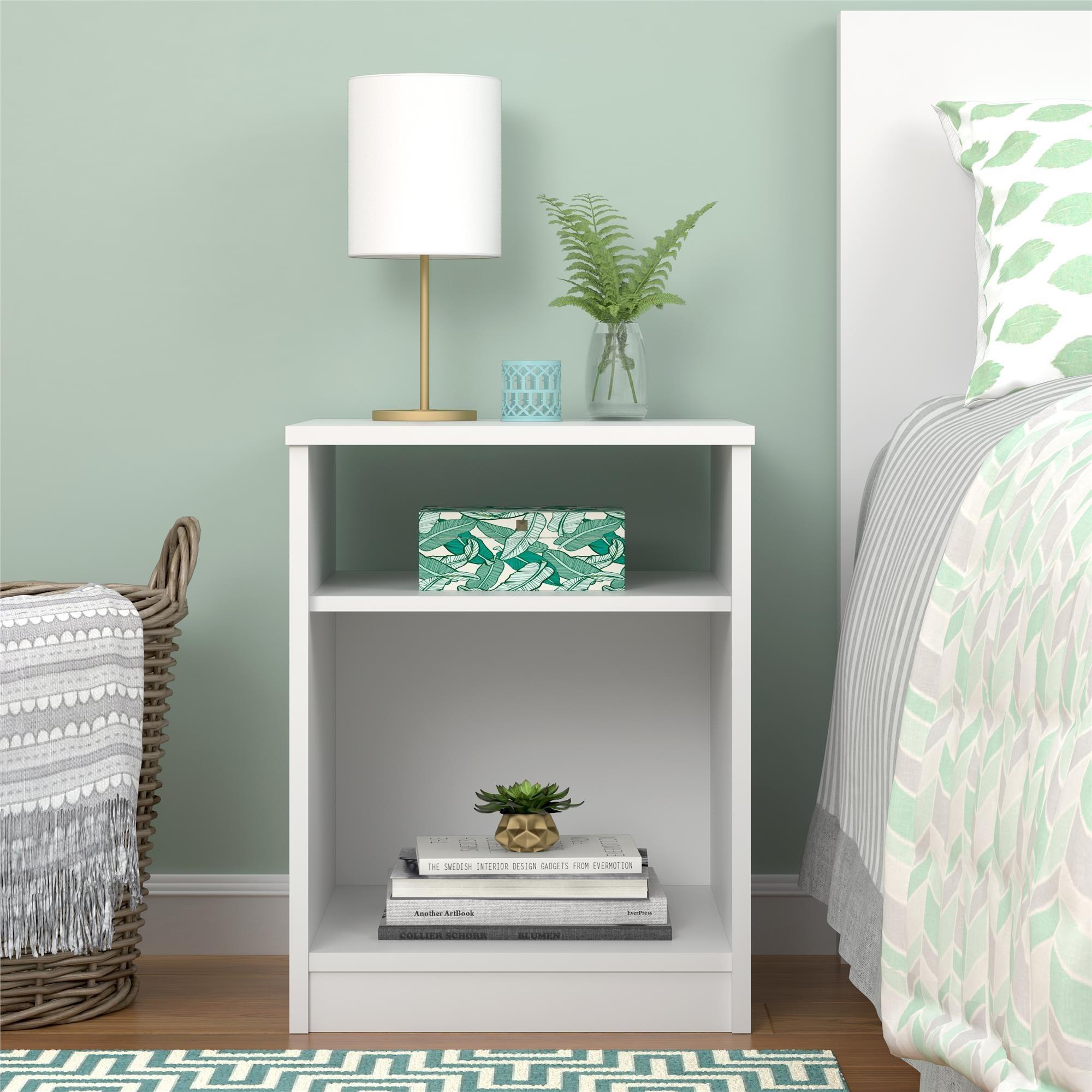 The white two-shelf nightstand