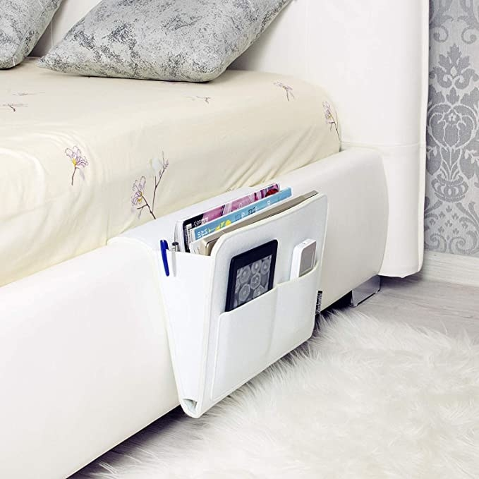 White bedside caddy attached to a bed