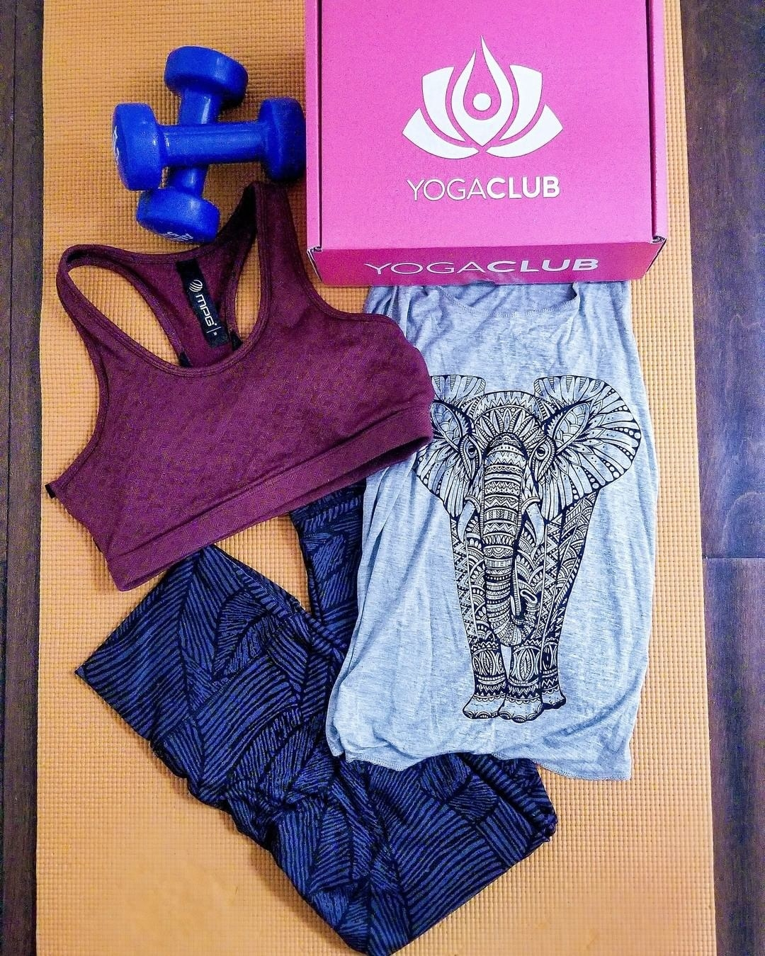 YogaClub pink box with magenta sports bra, black and dark blue print-leggings, and light blue top with elephant design