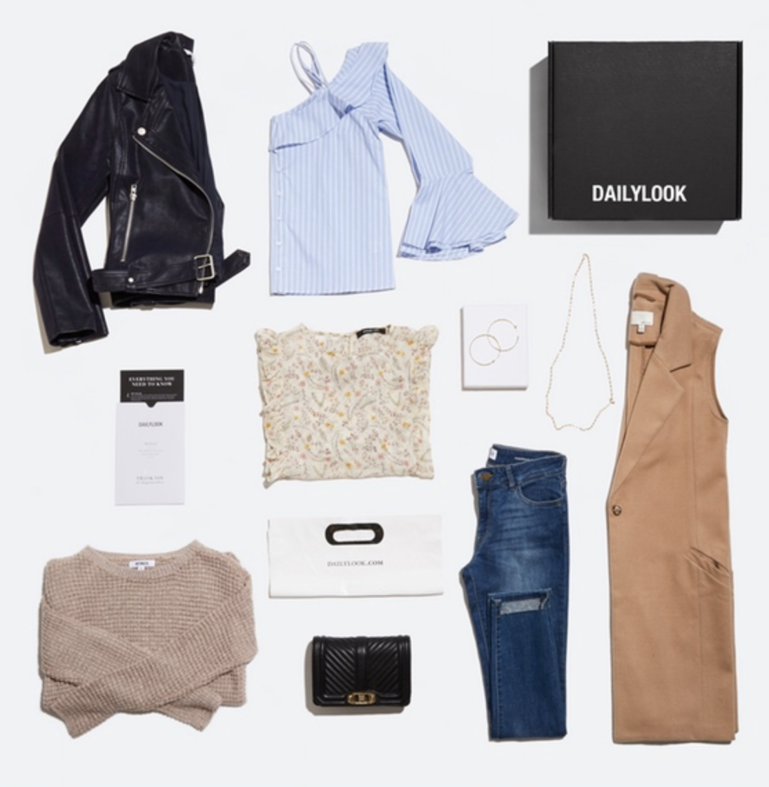 Dailylook subscription box items, including dark denim, an oatmeal sweater, and gold jewelry
