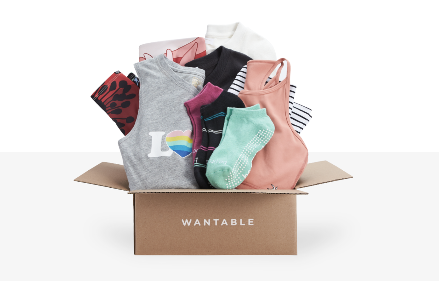 Wantable subscription box with mint green active leggings, pink tank top, and gray tank