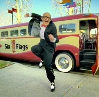 The Six Flags old man dancing in front of a Six Flags bus