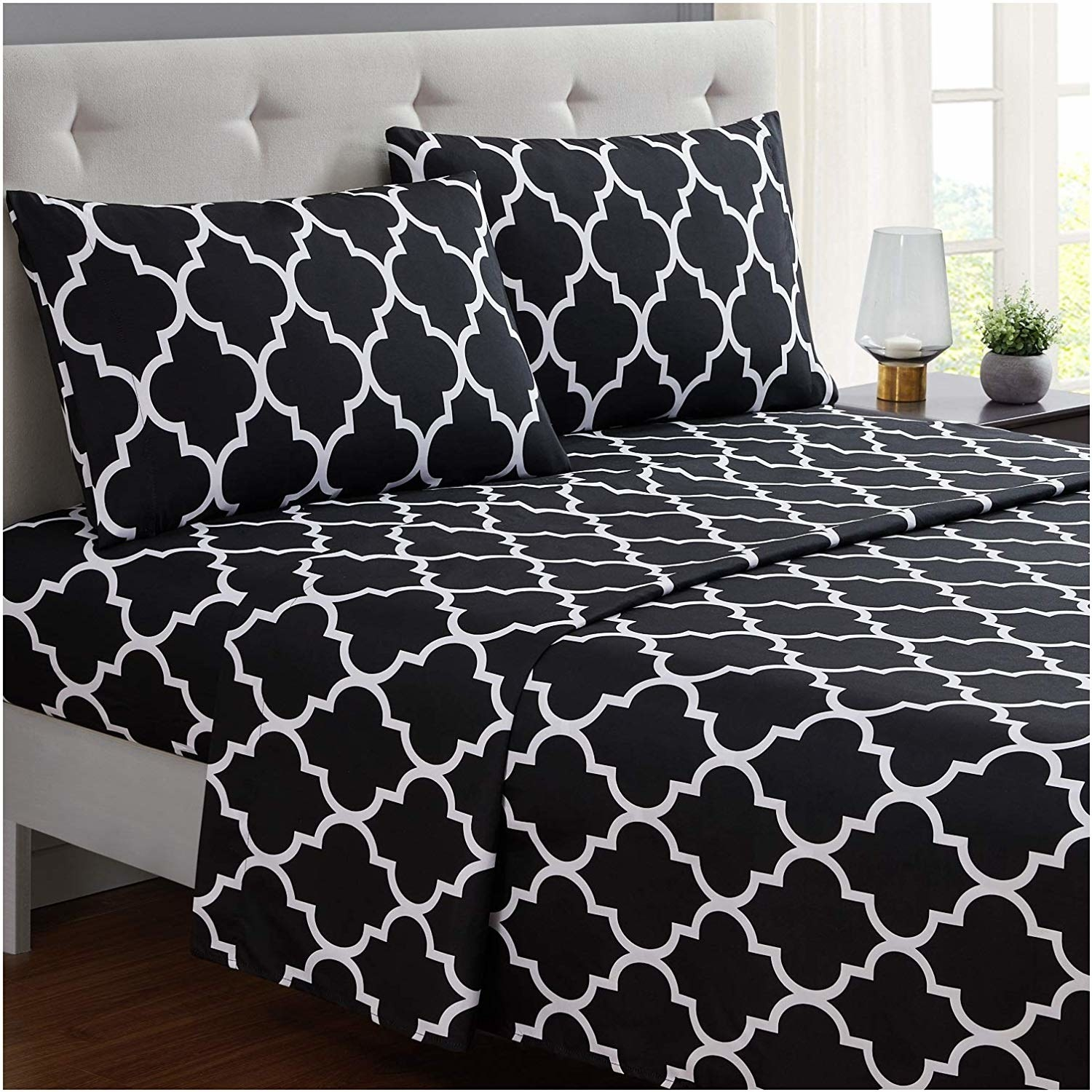 sheets on the bed along with the pillowcases. they're white and black.