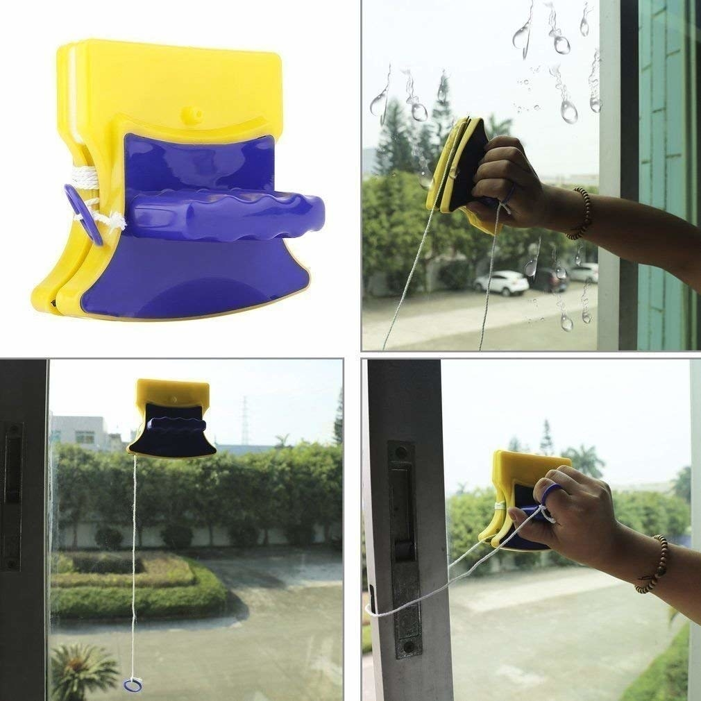 Magnetic window cleaners attached to both sides of a window, with a hand moving it around.