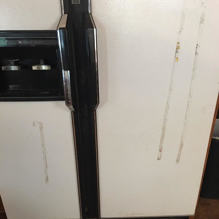 A fridge with gooey streaks on it