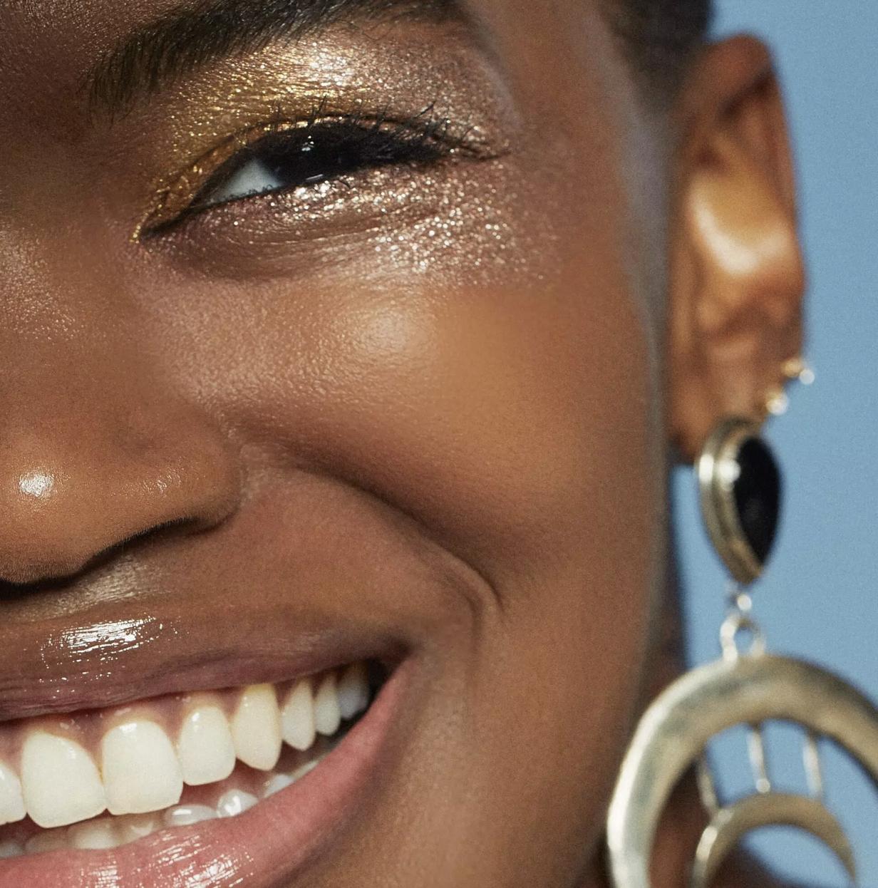 a model wearing gold shimmery eyeshadow
