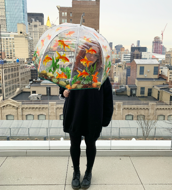 shopping writer mallory mower uses clear round umbrella with fish on it