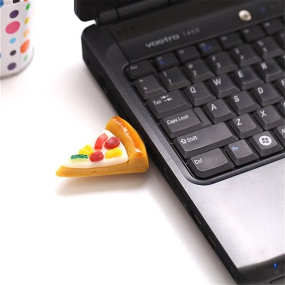 A close-up of a pizza-shaped USB key inserted into a laptop