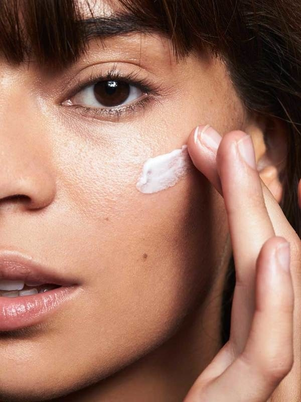 Model wearing the primer showing its creamy texture