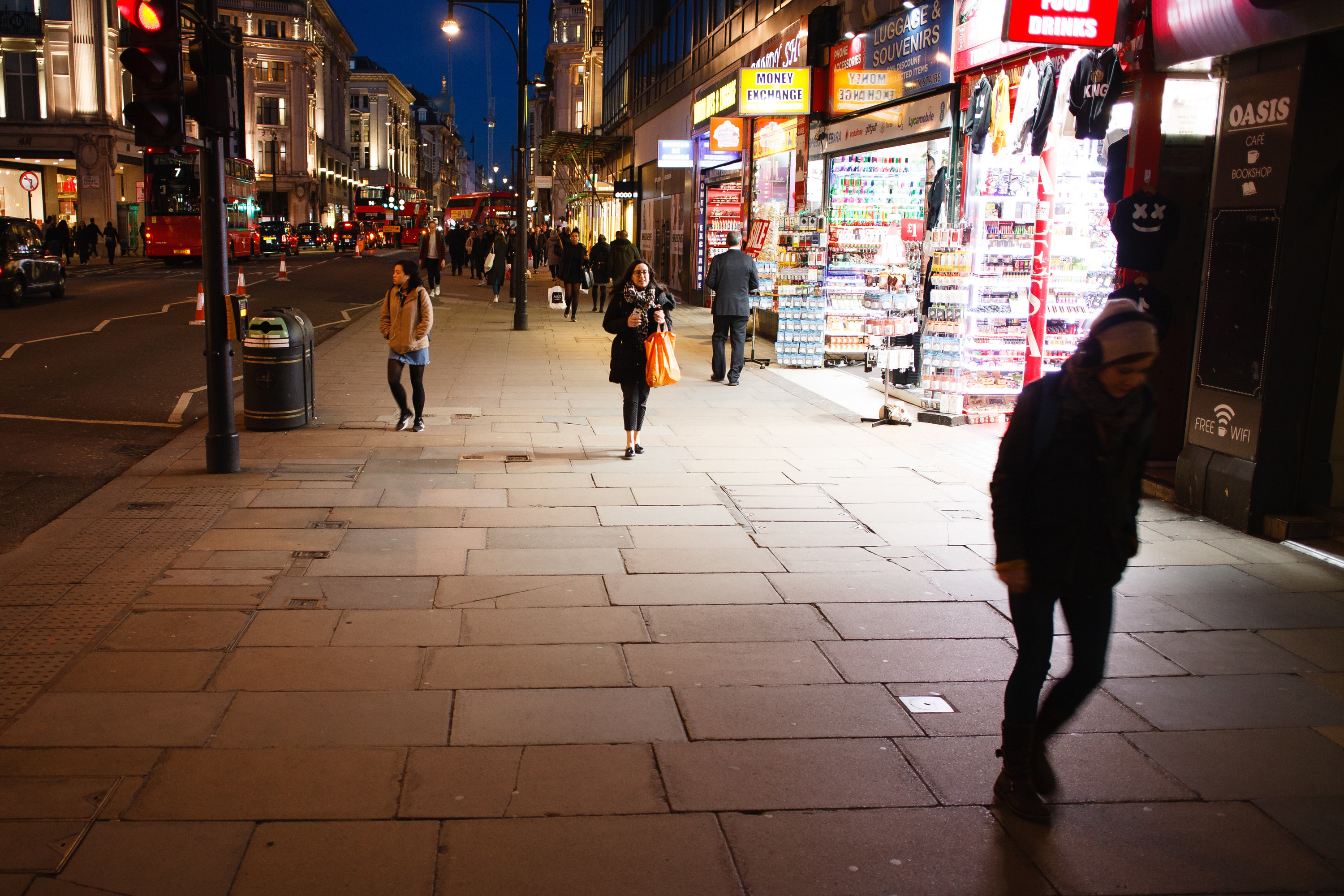 People walk along Oxford Street on March 16.