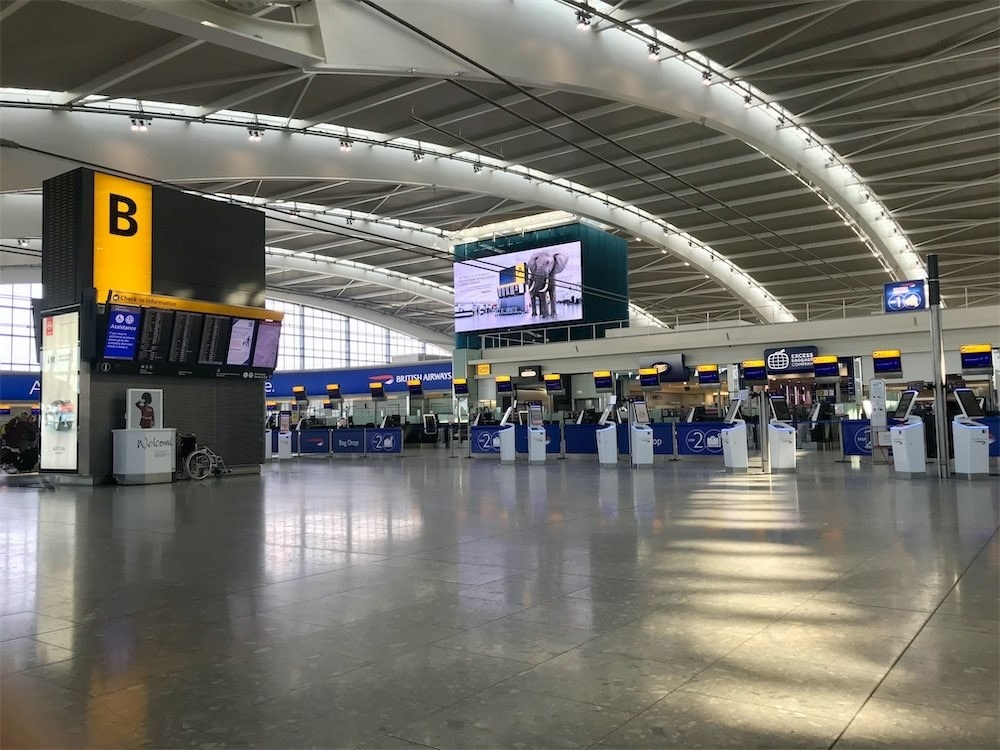 Heathrow Airport's Terminal 5 departure area is almost empty on March 12.