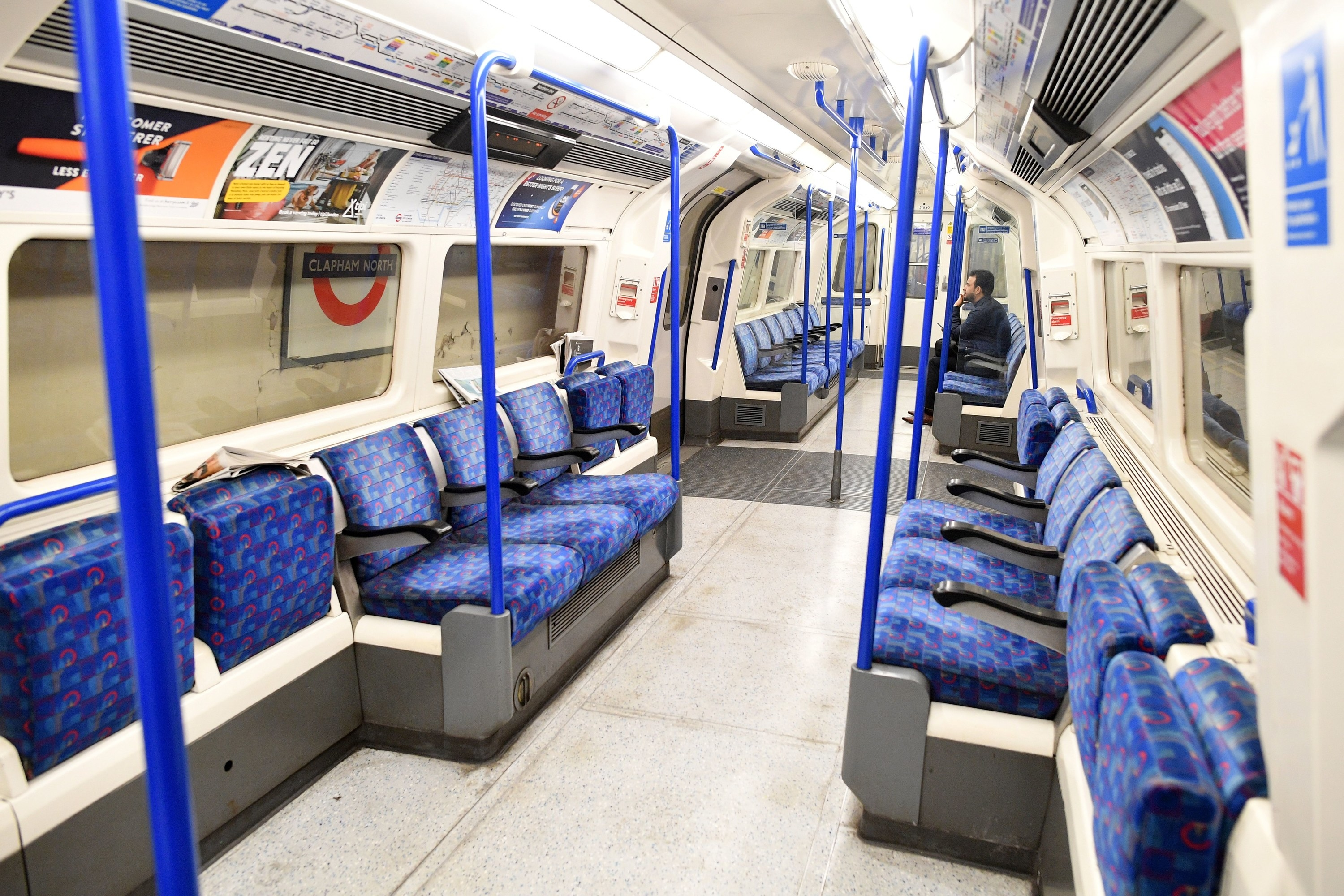 Few commuters travel on the train during the morning rush hour time at 0830 from Clapham North to central London on March 17.