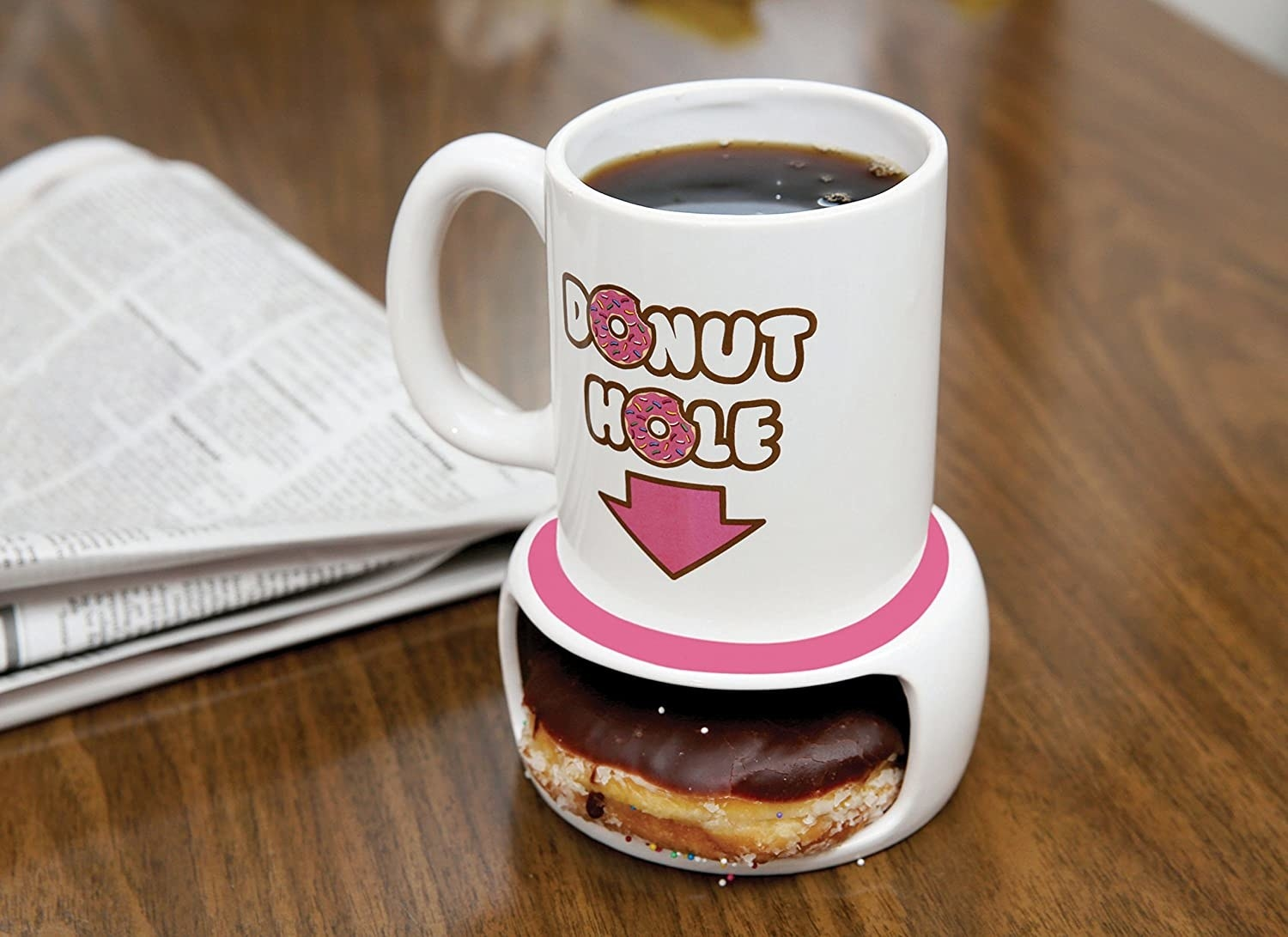 A donut in the bottom of the mug