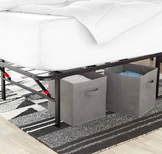 Gray foldable storage cubes under a big bed