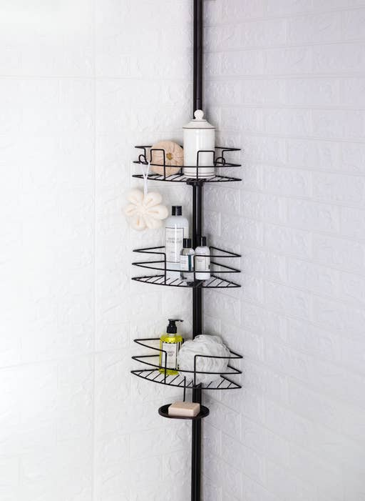 An image of a tension pole shower caddy
