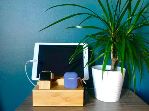 Bamboo charging station dock with a tablet and smartwatch