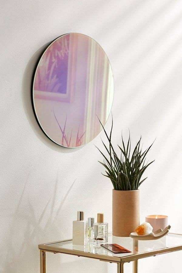 the mirror hanging on a wall