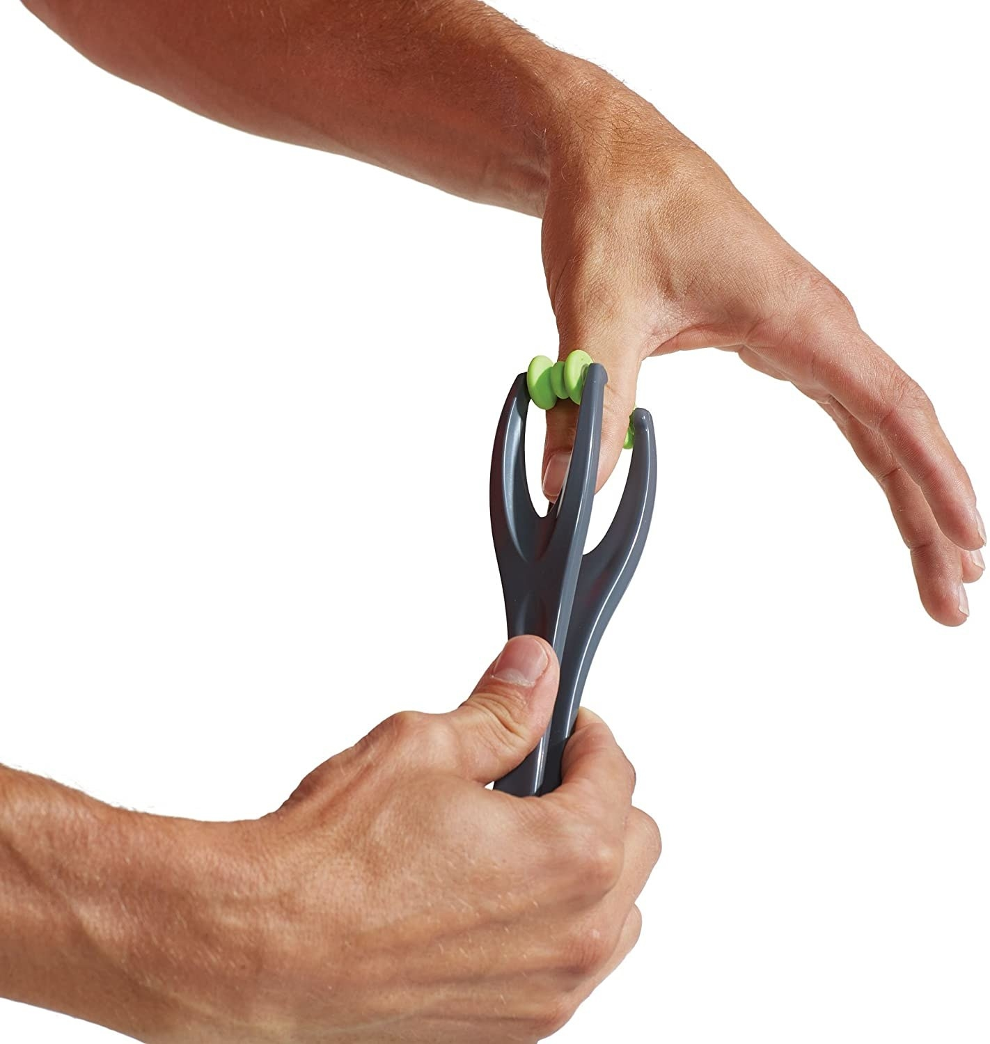 person using clamp-like massager with balls on the end to massage thumb