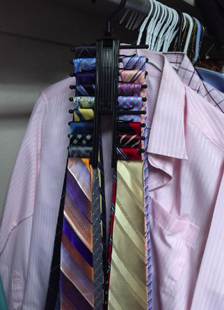 Reviewer shows tie rack holder with different colored ties in their closet