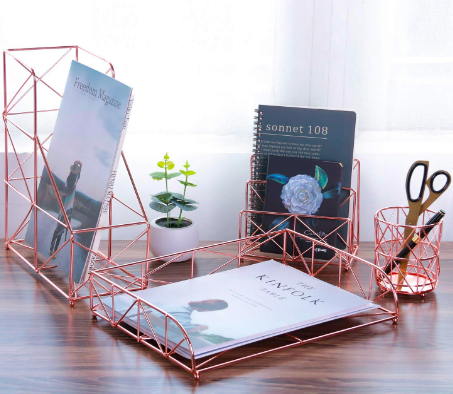 Rose gold desk organizer set with a pen cup, magazine holder, and letter holder