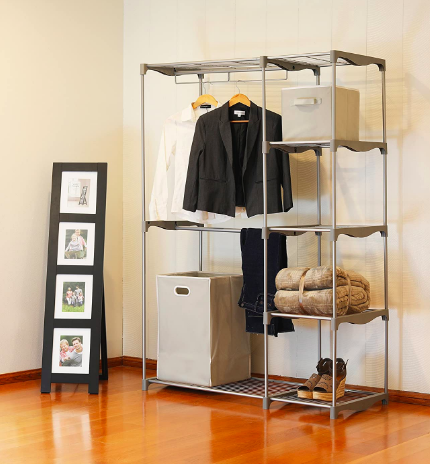 Silver free-standing garment closet with blazers, shoes, and storage cubes