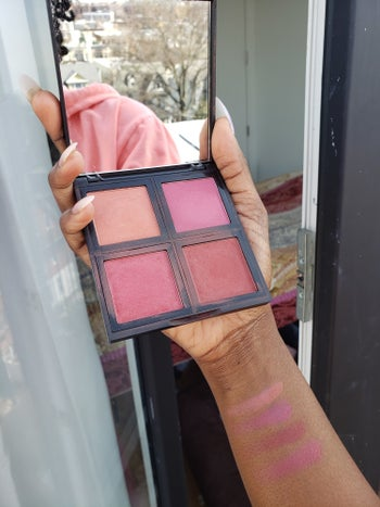 buzzfeed editor holding the palette of four colors