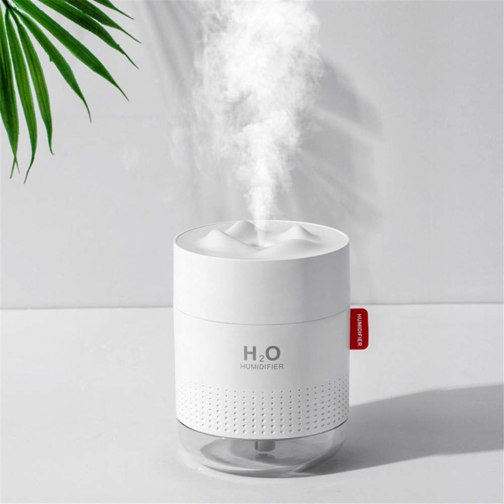 A close up of the sleek humidifier as it releases a cloud of vapour into the air