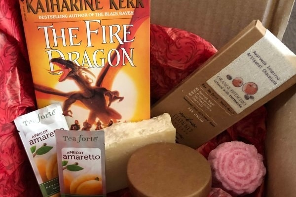 """""""The Fire Dragon"""" novel with tea and bath products"""