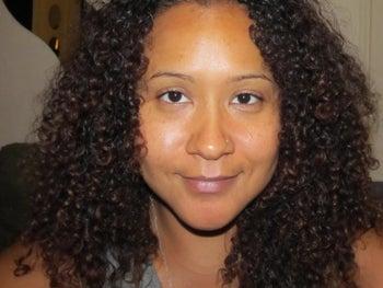 A photo of a user with bright, glowing skin. You can't see any breakouts or acne scars on her face