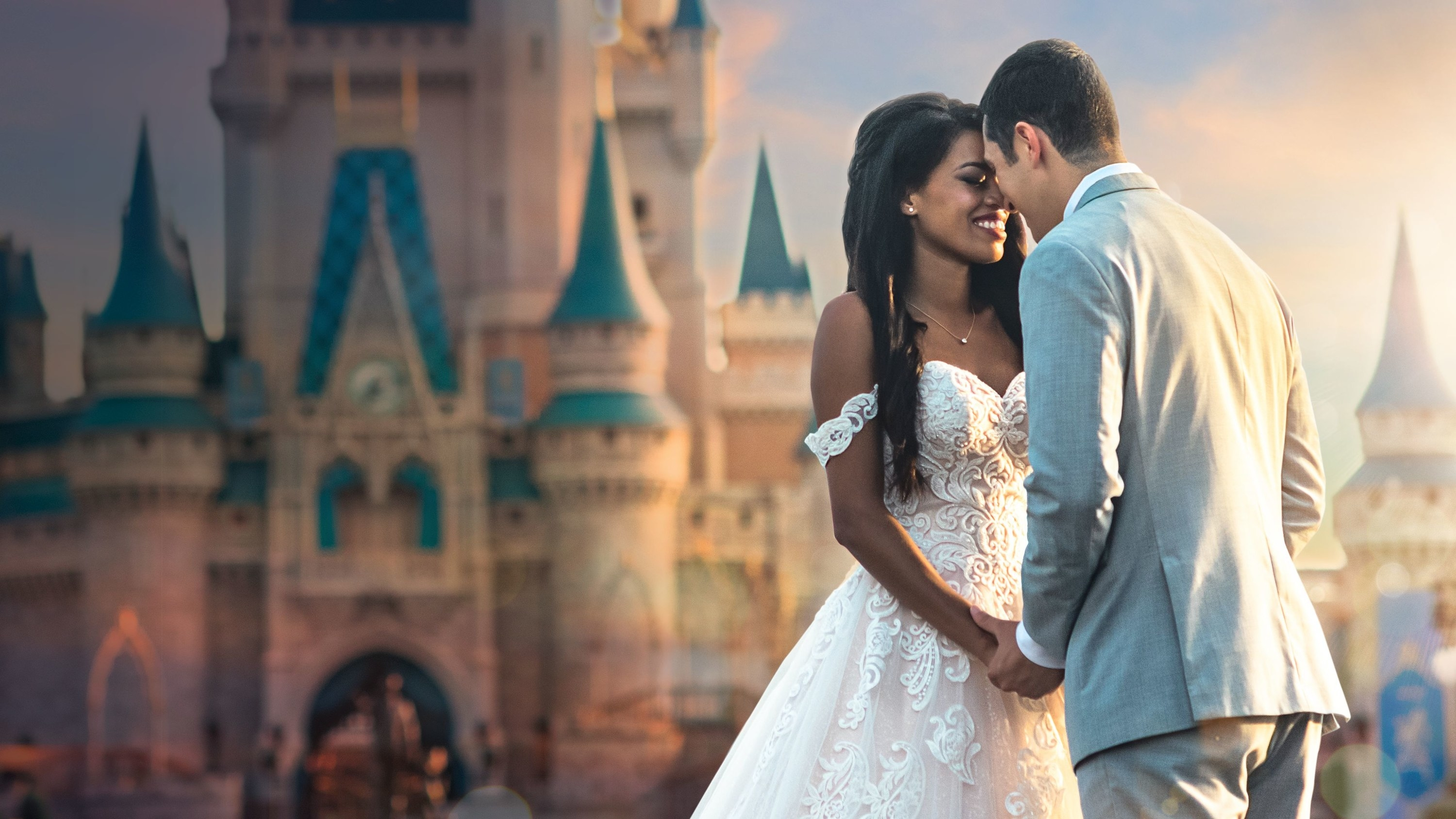 a couple dress for their wedding in front of cinderella castle