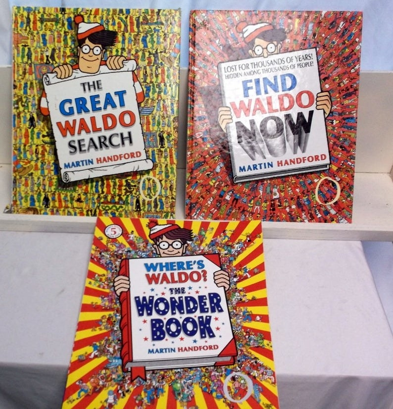 "Three ""Where's Waldo?"" books: ""The Great Waldo Search,"" ""Find Waldo Now,"" and ""T Wonder Book"""