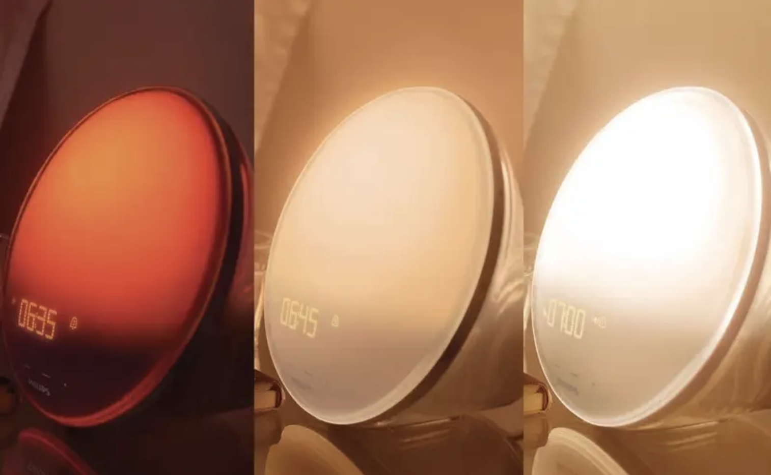 A sunrise alarm clock in three stages of lighting up from dim to brighter to brightest over the course of a half hour