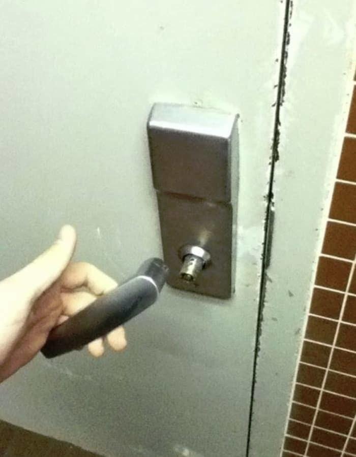Picture of a door handle breaking off a door