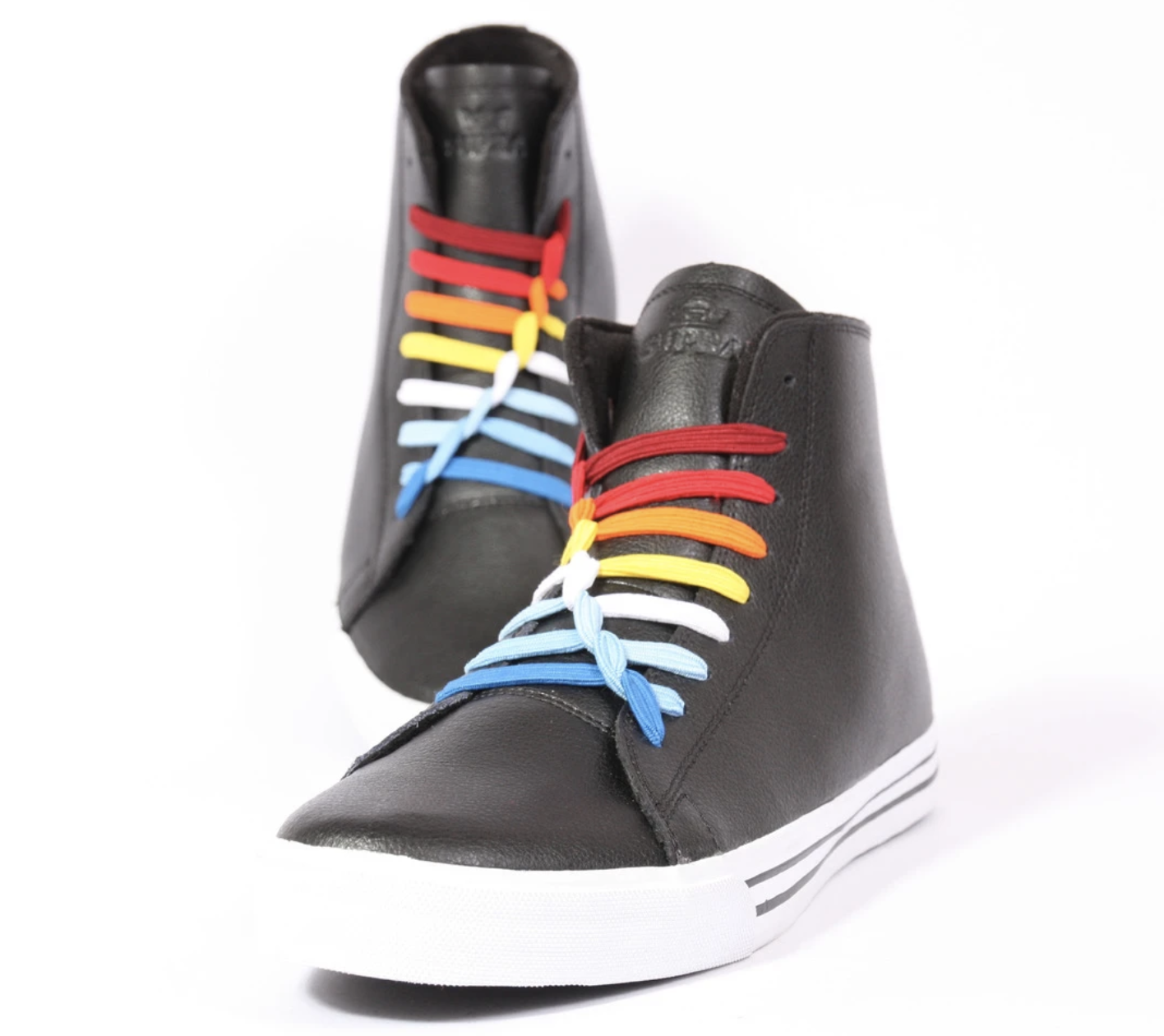 A pair of sneakers with rainbow U-laces