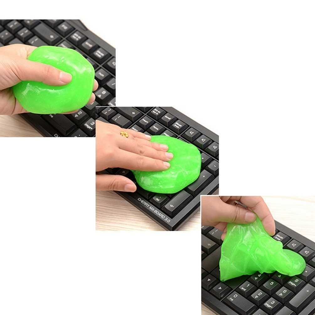 A person using the bright green cleaning slime to clean a keyboard.