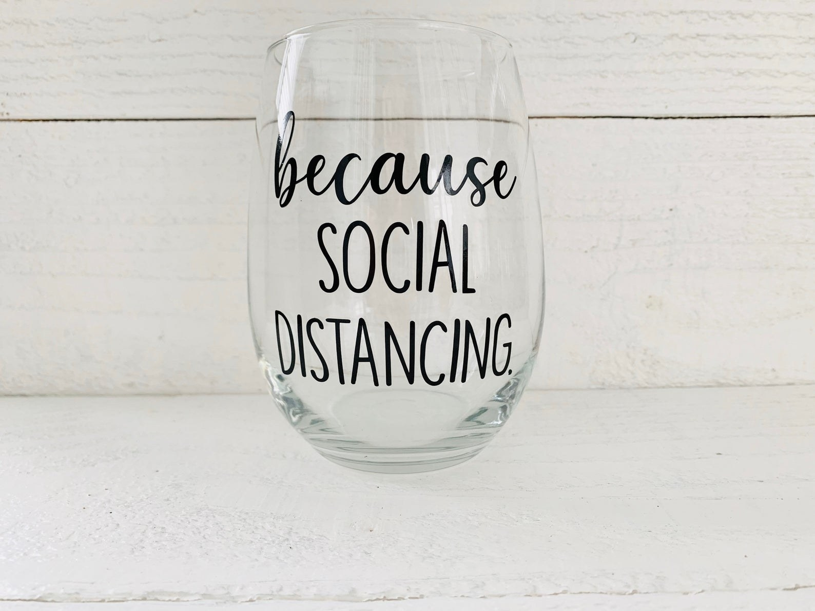 """transparent wine glass that says """"because social distancing"""""""